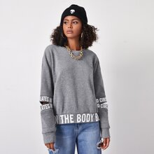 Cut Out Detail Slogan Graphic Pullover