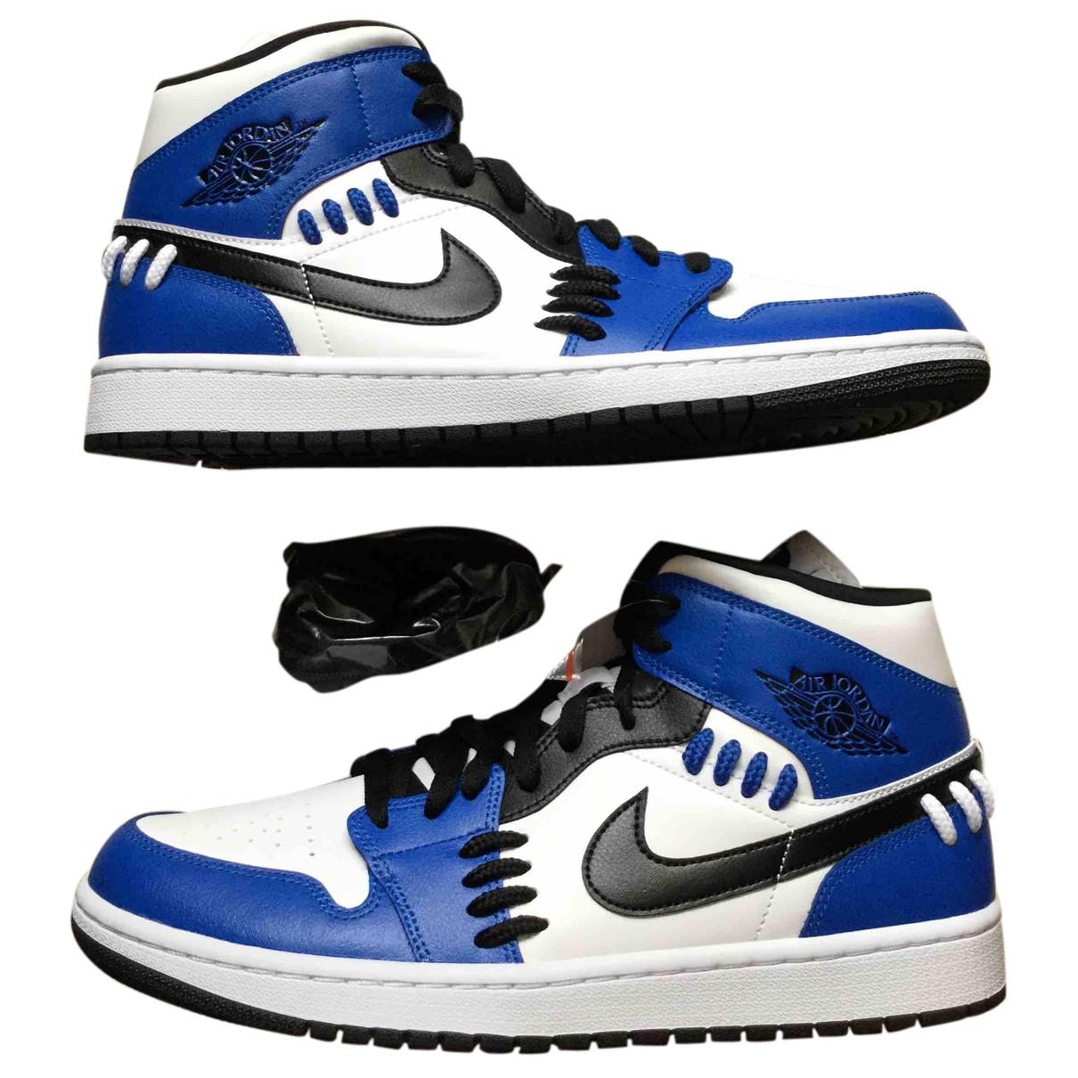Jordan - Baskets Air Jordan 1  pour femme en cuir - bleu