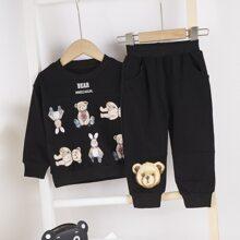 Sudadera con estampado de oso de dibujos animados y letra con pantalones deportivos