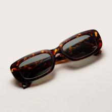 Sonnenbrille mit Leopardenrahmen