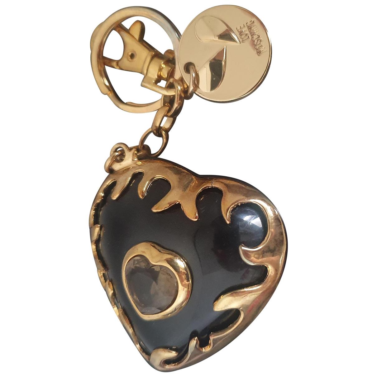 Moschino \N Taschenschmuck in  Gold Metall