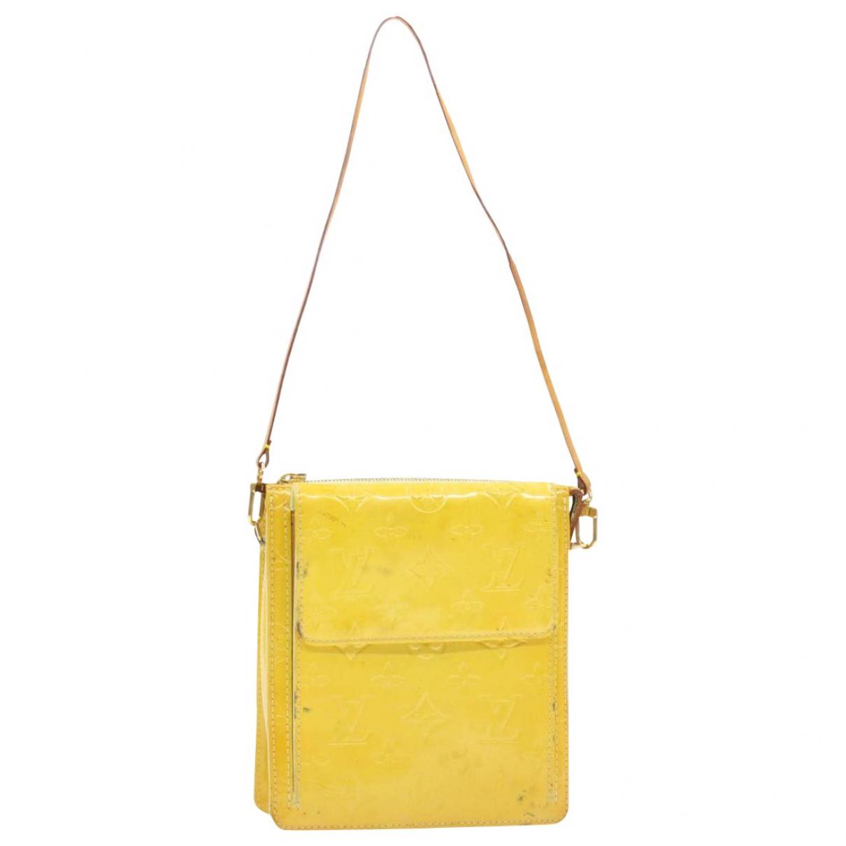 Louis Vuitton - Sac de voyage   pour femme en cuir verni - jaune