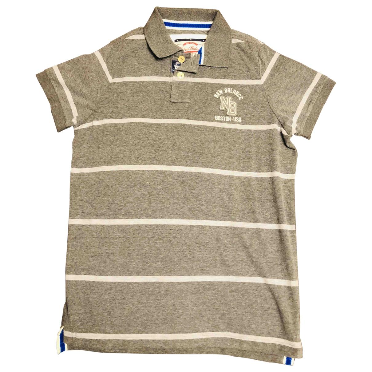 New Balance - Polos   pour homme en coton - gris
