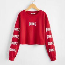 Crop Pullover mit Buchstaben Grafik und sehr tief angesetzter Schulterpartie