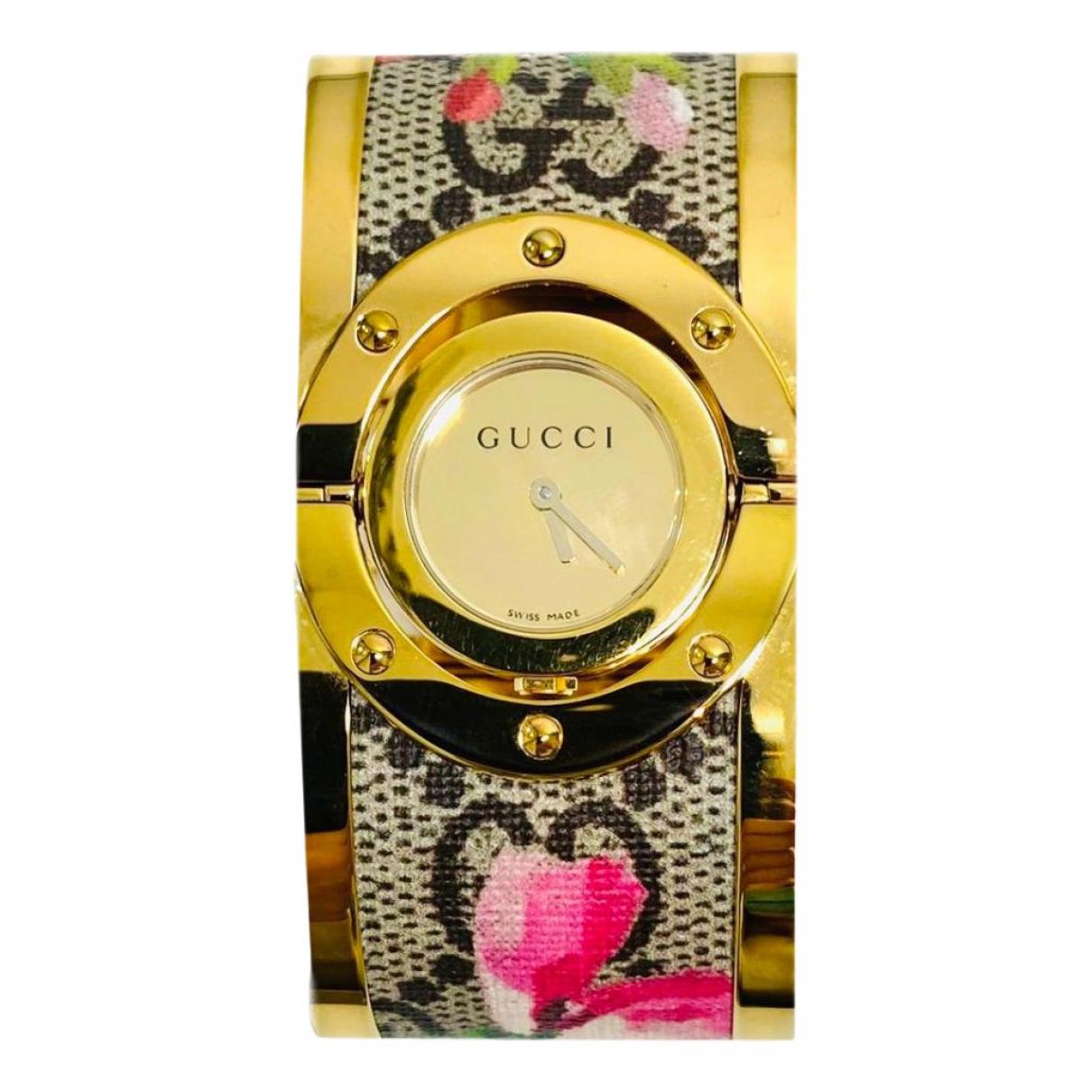 Gucci - Montre Twirl pour femme en plaque or - multicolore