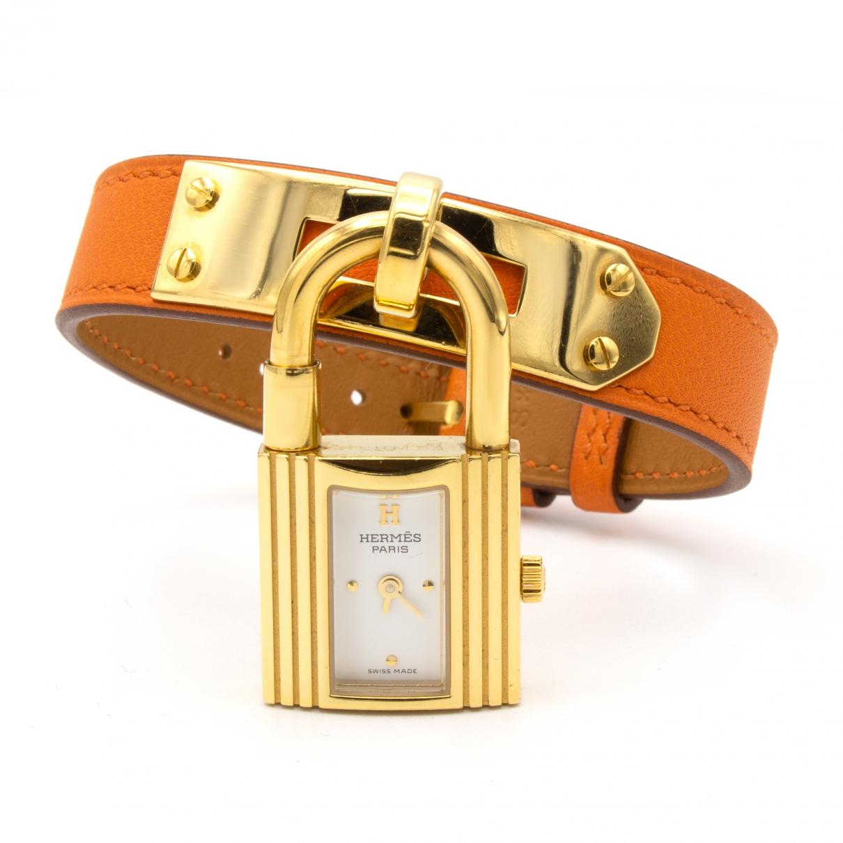 Hermes - Montre Kelly pour femme en plaque or - orange