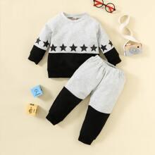 Sudadera con estampado de estrella de color combinado con pantalones deportivos