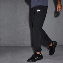 Pantalones deportivos con estampado de letra reflexiva
