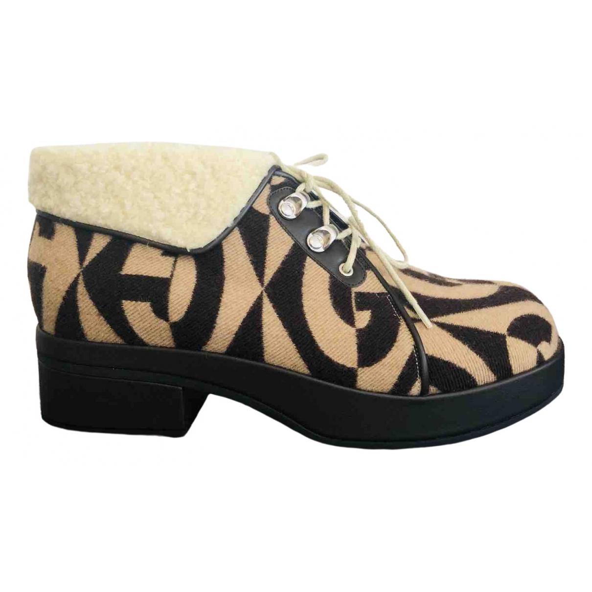 Gucci - Boots   pour femme en fourrure synthetique - marron