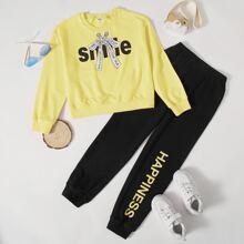 Conjunto pullover con estampado de letra con pantalones