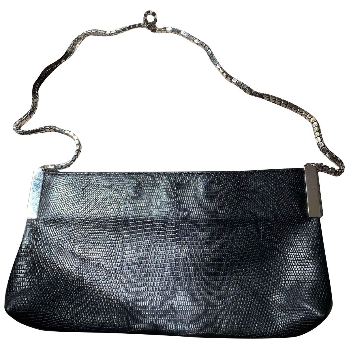Swarovski \N Black Crocodile Clutch bag for Women \N
