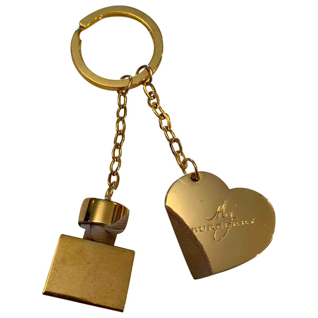 Burberry - Bijoux de sac   pour femme en or - dore