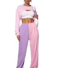 Pantalones deportivos de dos colores de cintura elastica