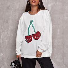 Pullover mit sehr tief angesetzter Schulterpartie und Karikatur Grafik