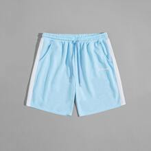Shorts mit Farbblock und Buchstaben Grafik