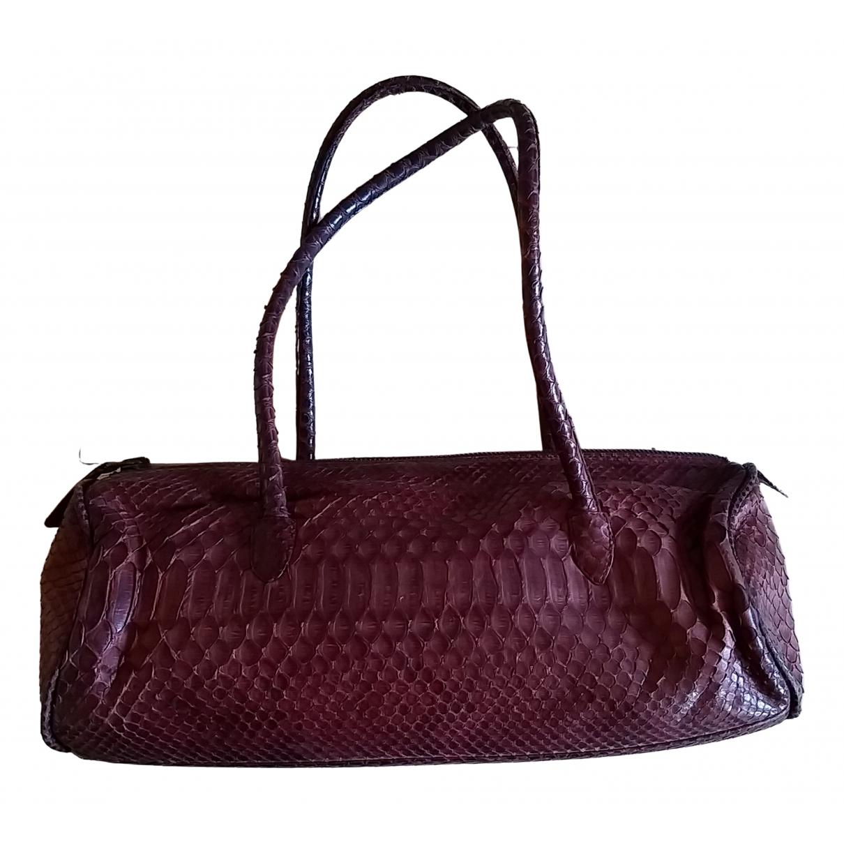 Reptiles House N Pink Alligator handbag for Women N