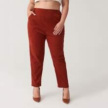 Hose mit elastischer Taille und schraegen Taschen