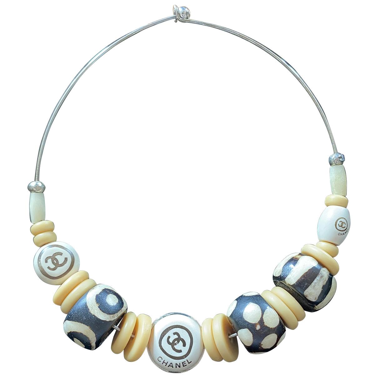Chanel - Collier   pour femme en bois - beige