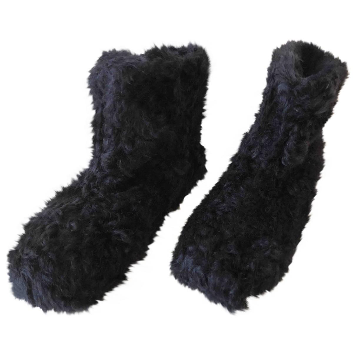 Miu Miu - Boots   pour femme en fourrure synthetique - noir