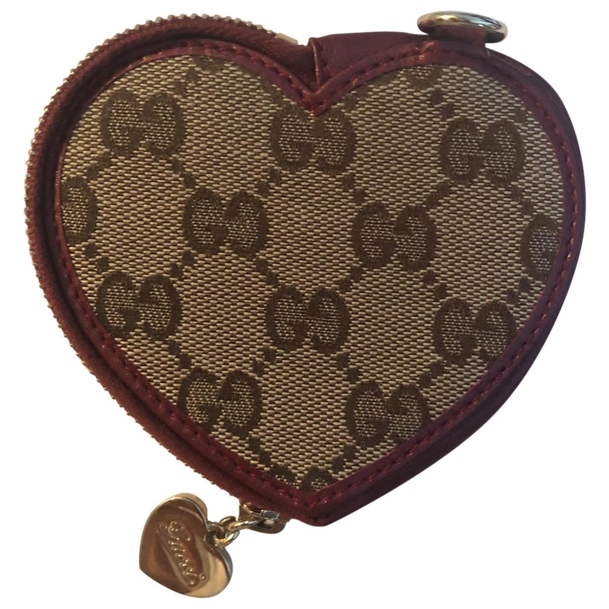 Gucci - Portefeuille   pour femme en toile - bordeaux