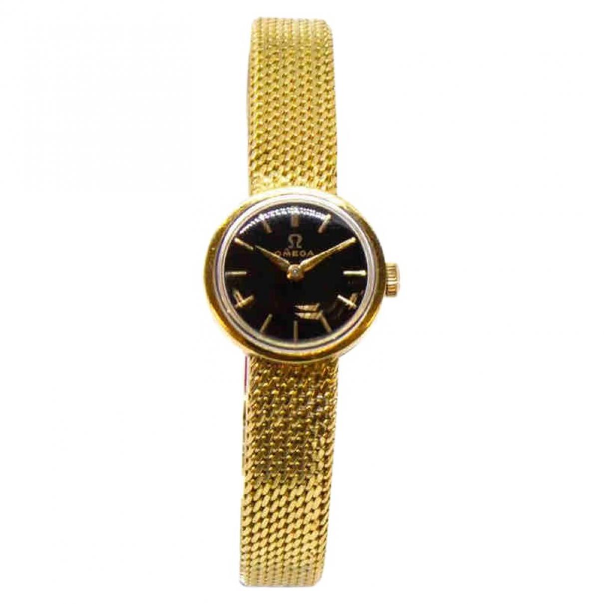 Omega - Montre   pour femme en or jaune - dore