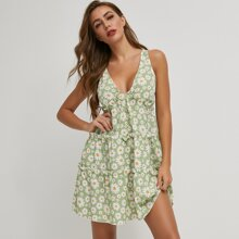 Kleid mit tiefem Kragen, Rueschenbesatz und Gaensebluemchen Muster