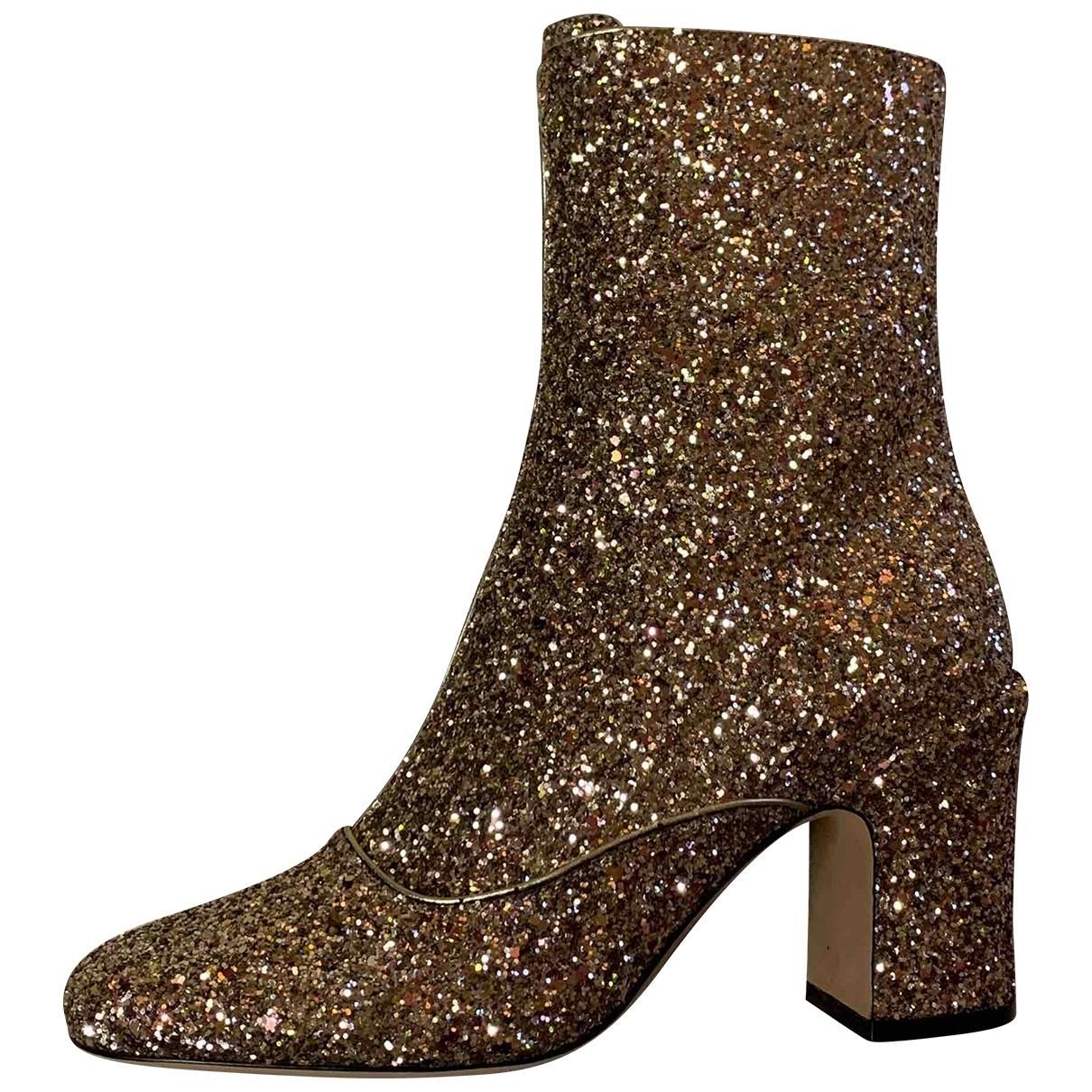 Dior - Boots   pour femme en a paillettes - dore