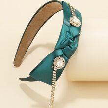 Aro de pelo con diseño de nudo con perla artificial