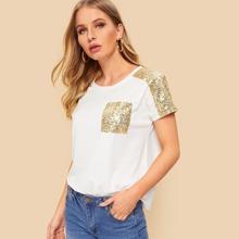 Camiseta con bolsillo con lentejuelas en contraste