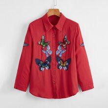 Bluse mit Schmetterling Stickereien und gebogenem Saum