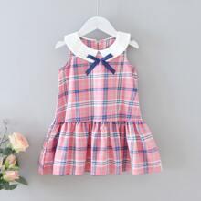 Kleinkind Maedchen Kleid mit Karo Muster, Schleife vorn und Raffungsaum