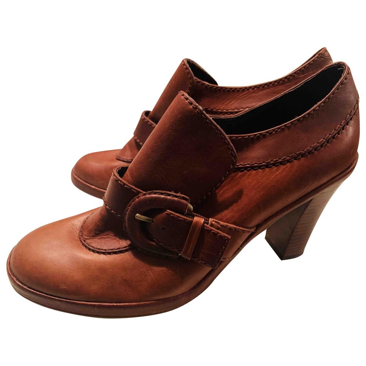 Tommy Hilfiger - Bottes   pour femme en cuir - marron