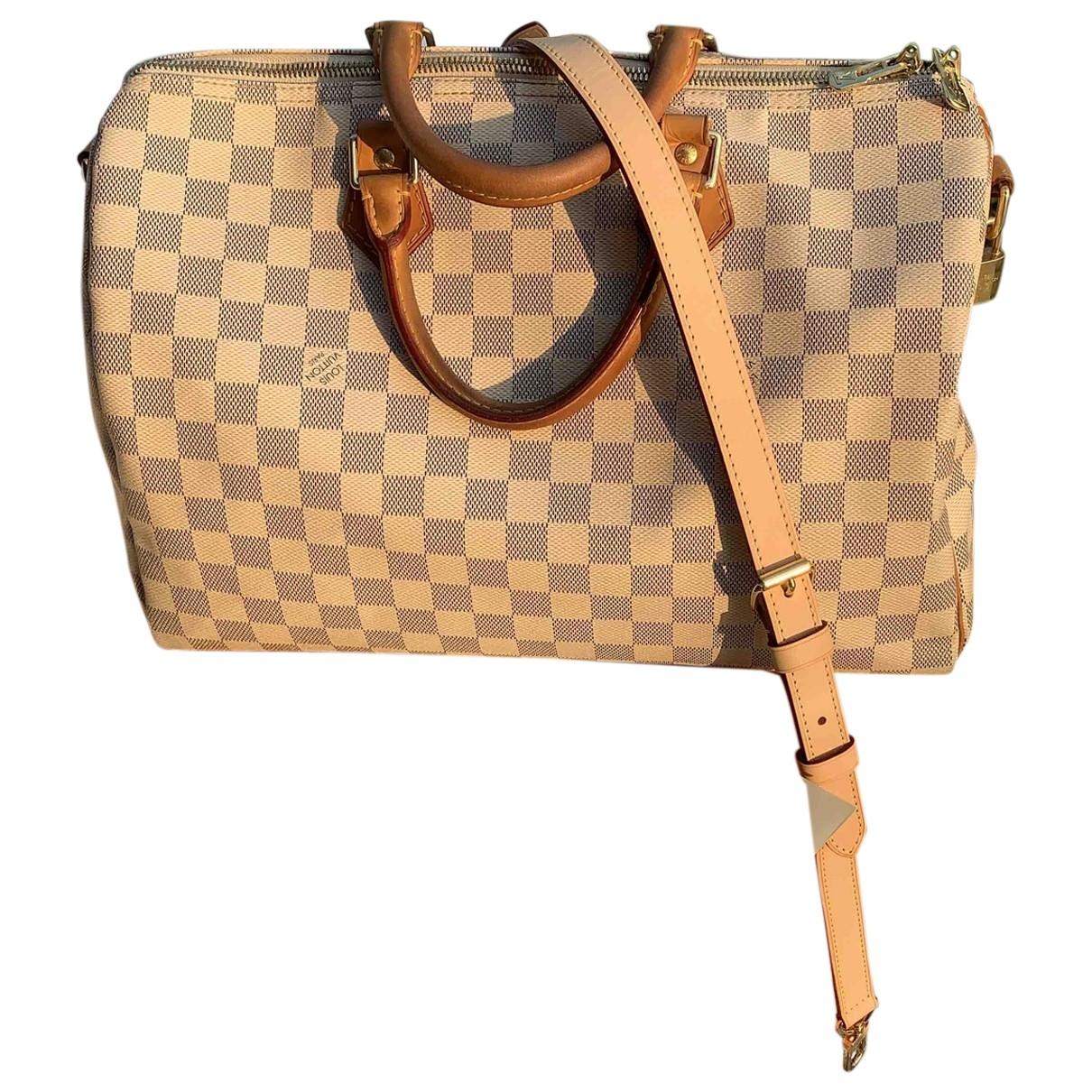 Louis Vuitton Speedy Bandoulière Beige Cloth handbag for Women \N