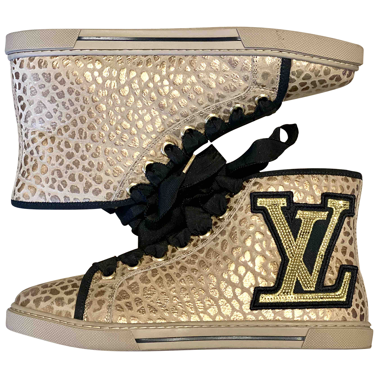 Louis Vuitton Stellar Sneakers in  Gold Leder