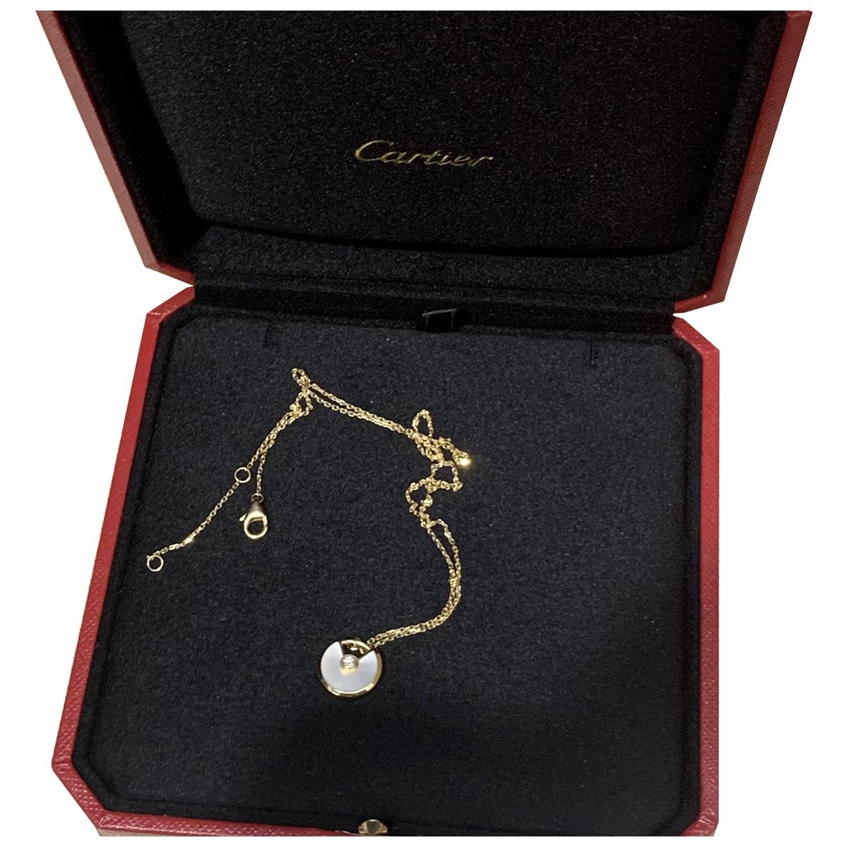 Cartier Amulette Kette in  Beige Gelbgold