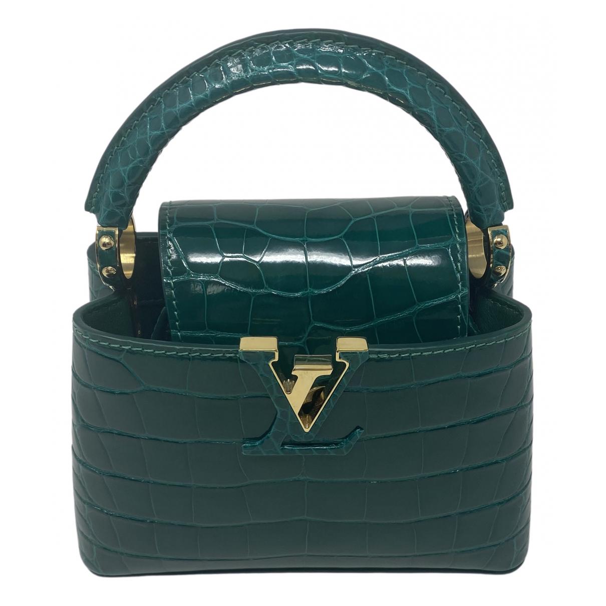 Louis Vuitton Capucines Handtasche in  Gruen Aligator