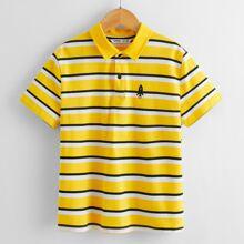 Polo Shirt mit Rakete Stickereien und Streifen