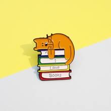 Broche de niños con diseño de libro y gato