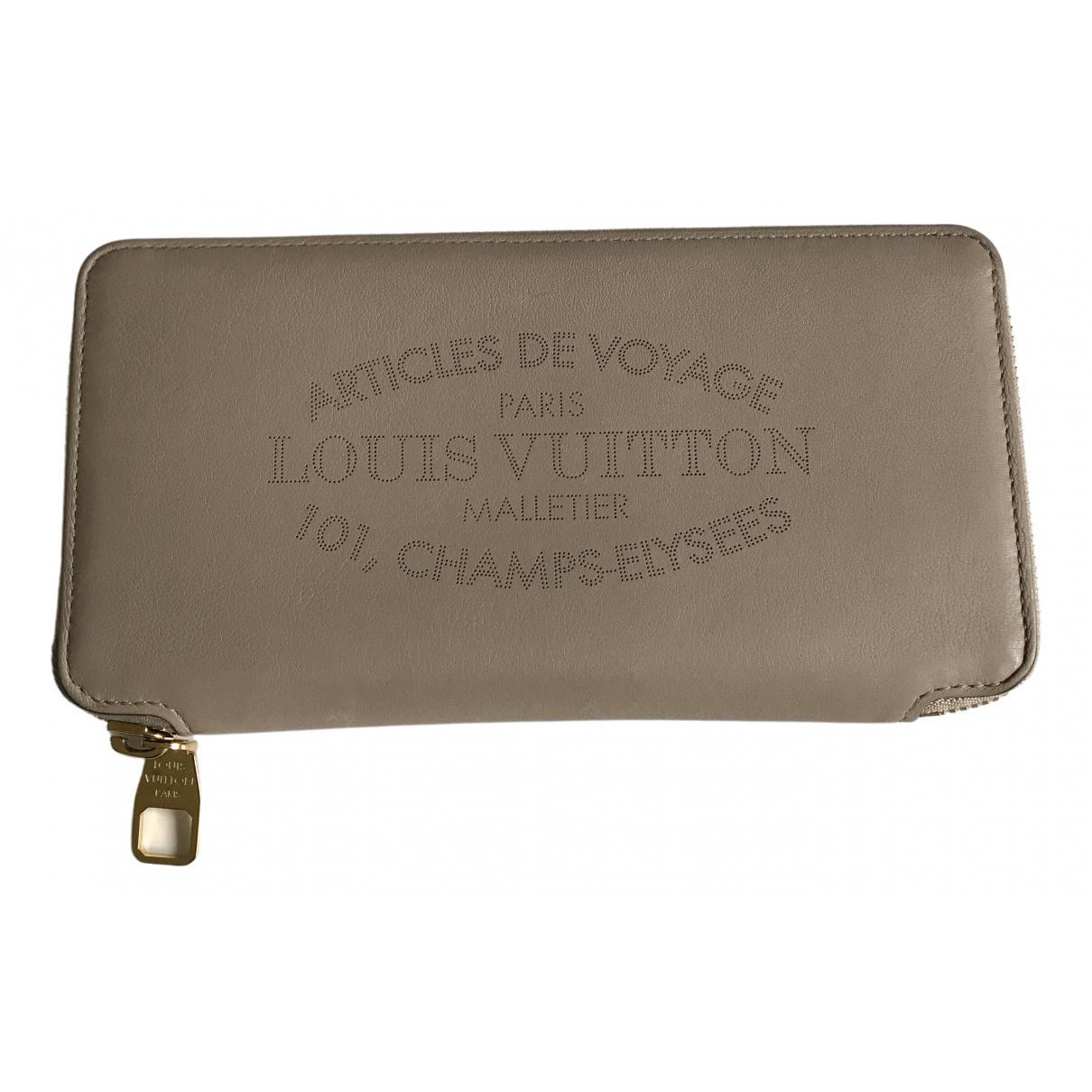 Louis Vuitton - Portefeuille Zippy pour femme en cuir - beige