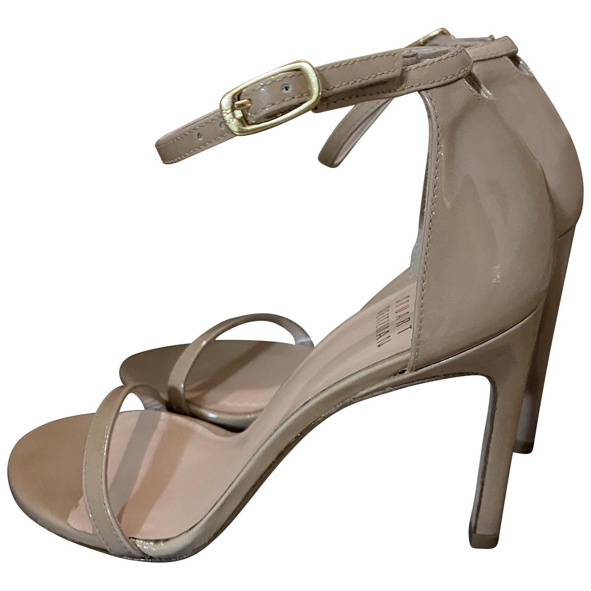 Stuart Weitzman - Sandales   pour femme en cuir verni - beige