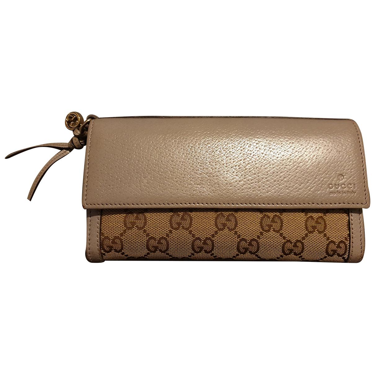 Gucci - Portefeuille Ophidia pour femme en toile - beige