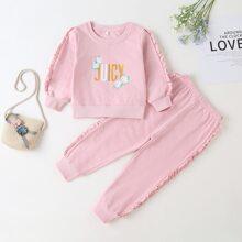 Sweatshirt & Jogginghose mit Rueschen und Buchstaben Grafik