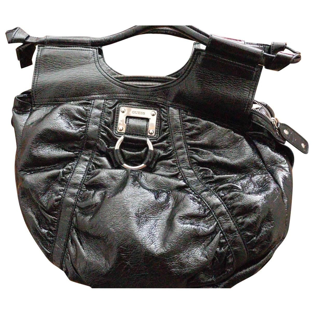 Guess \N Handtasche in  Schwarz Kunststoff