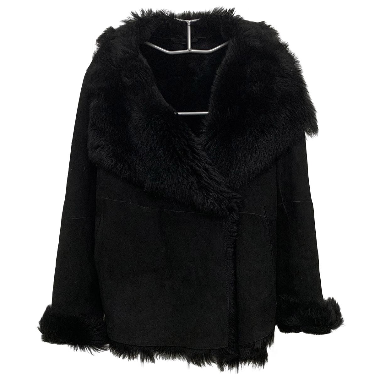 Gerard Darel \N Black Shearling Leather jacket for Women 44 FR