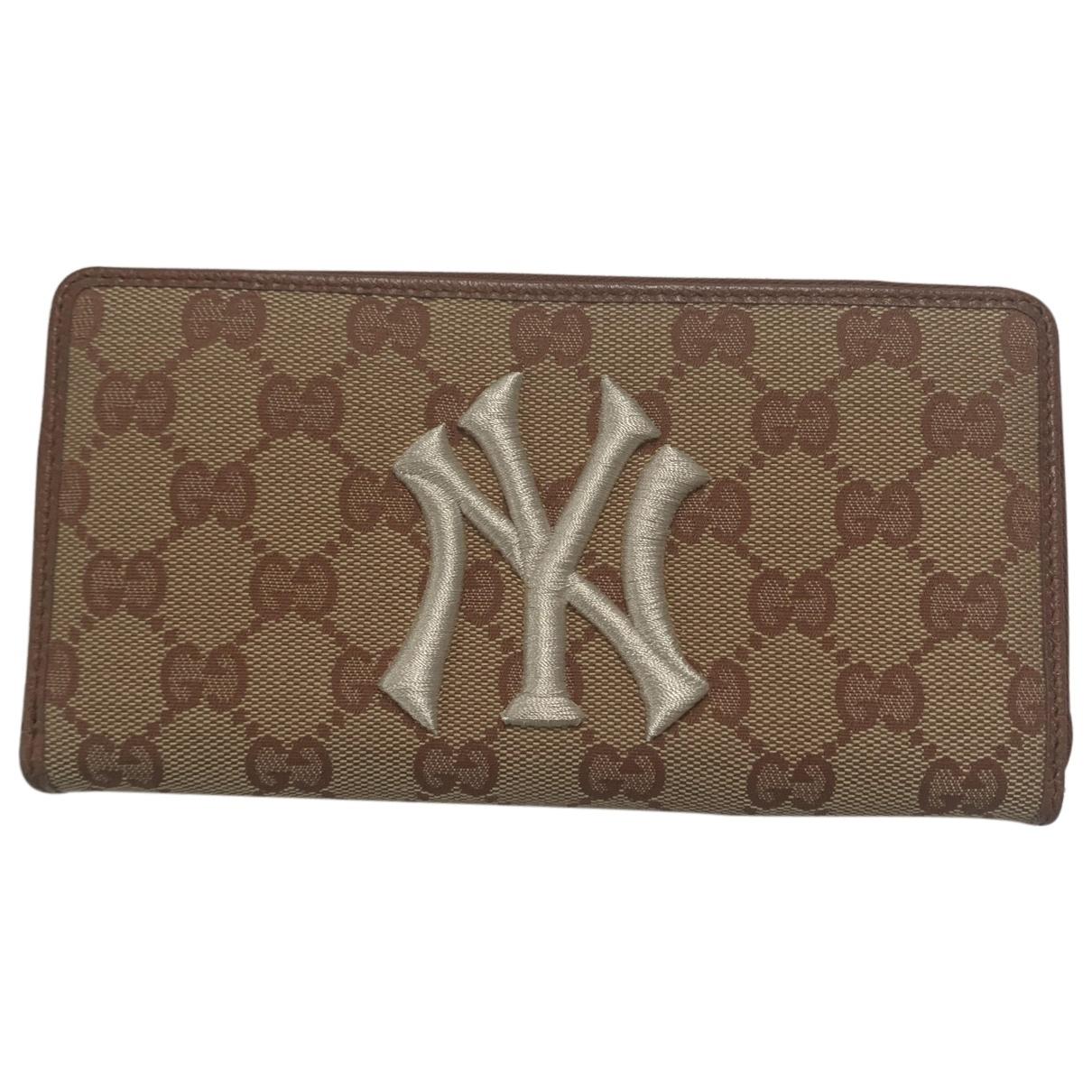 Gucci - Portefeuille Continental pour femme en toile - marron