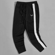 Jogginghose mit Grafik Muster, Kontrast und seitlicher Naht