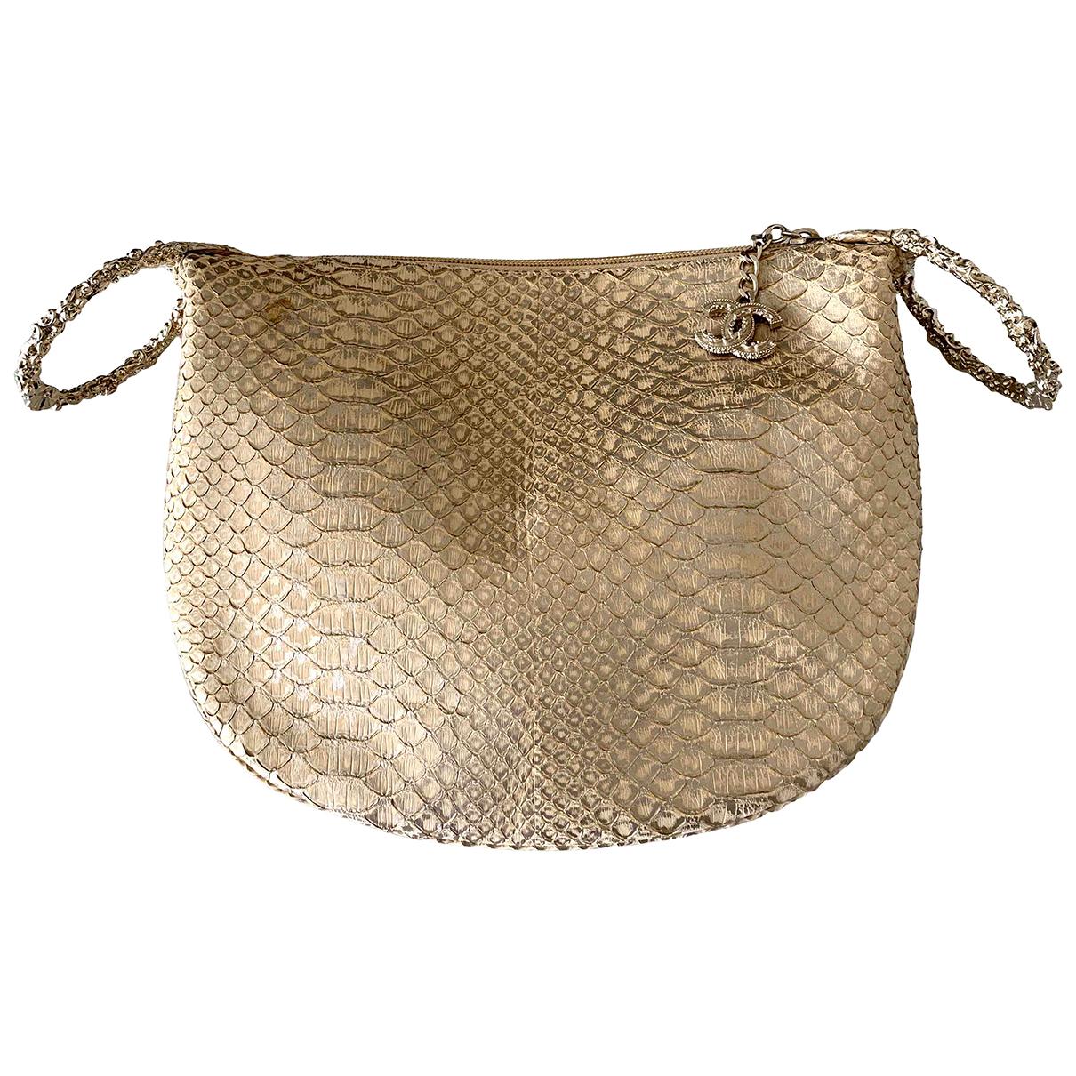 Chanel \N Clutch in  Gold Python