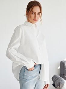 Camisa con boton de hombros caidos
