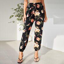 Pantalones deportivos cortos con nudo floral