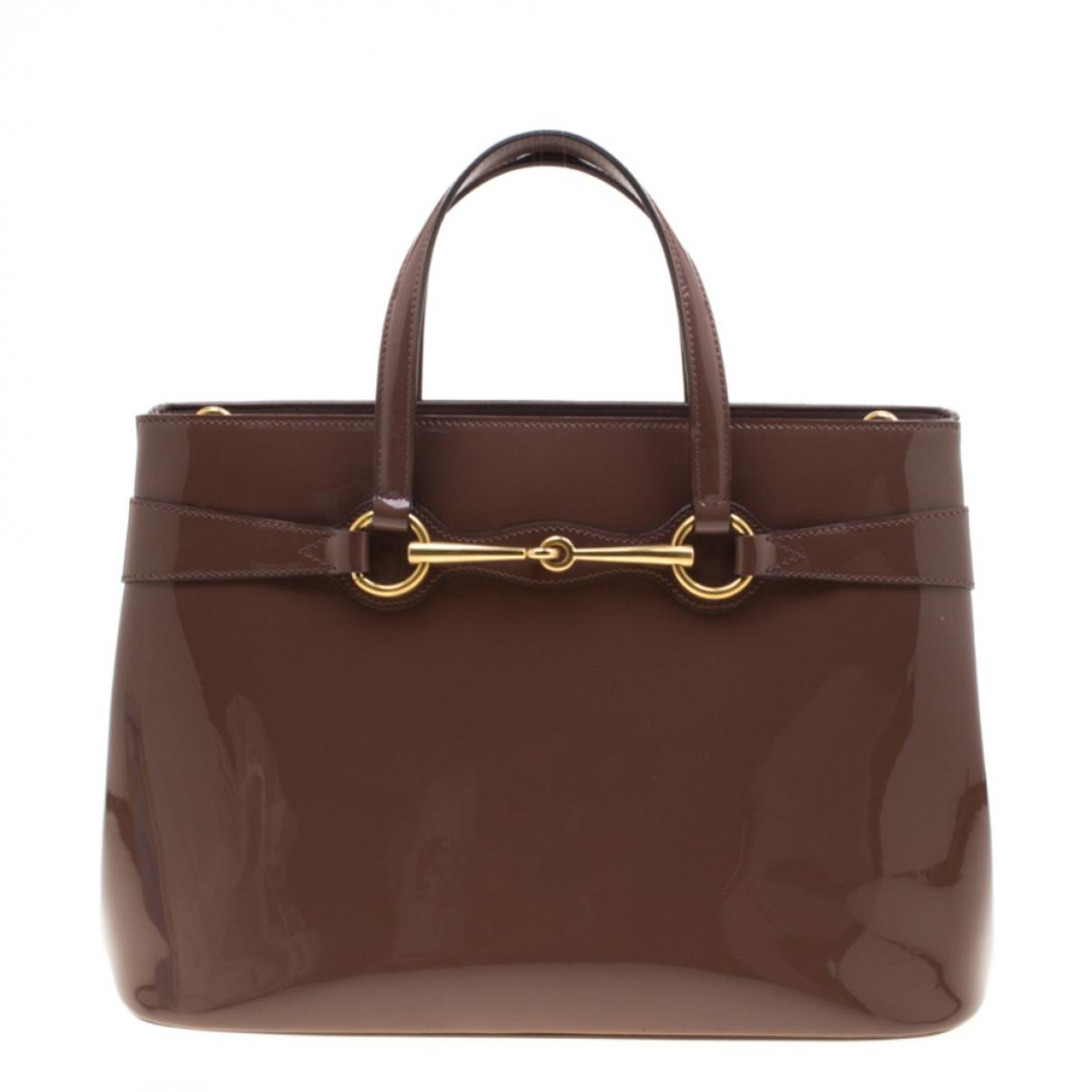 Gucci \N Handtasche in  Braun Lackleder